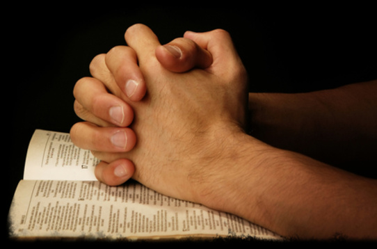 Praying Hands On Scripture