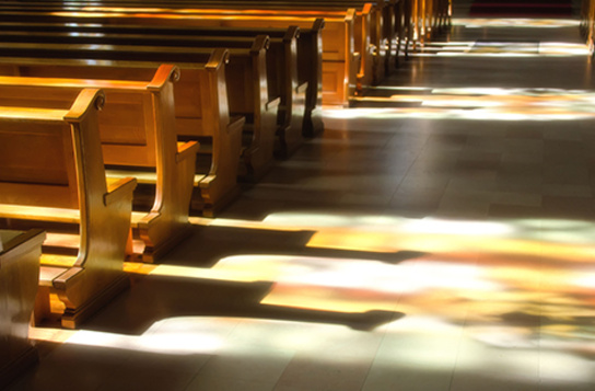 Sunlight bouncing off church pews